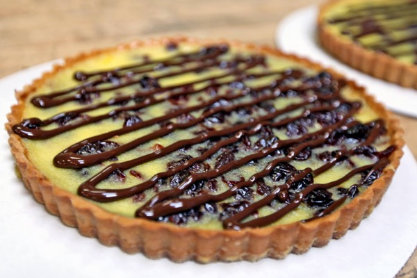Housemade custard tart with tart cherries and chocolate.